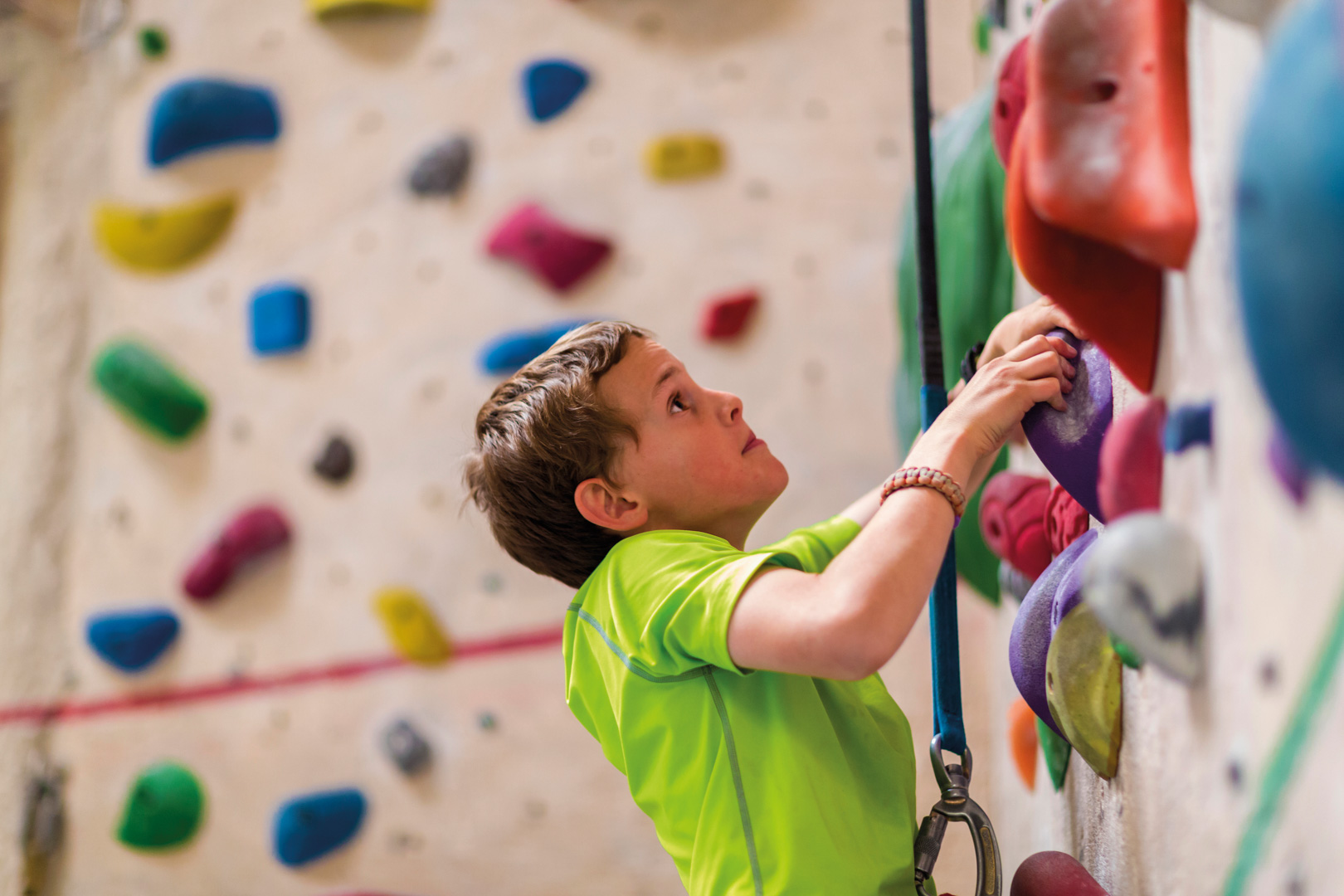 Young boy on climbing wall